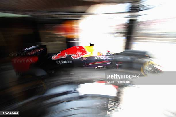 Sebastian Vettel of Germany and Infiniti Red Bull Racing exits his team garage to drive during qualifying for the Hungarian Formula One Grand Prix at...