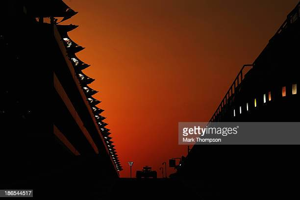 Sebastian Vettel of Germany and Infiniti Red Bull Racing exits the pit lane as he drives during practice for the Abu Dhabi Formula One Grand Prix at...