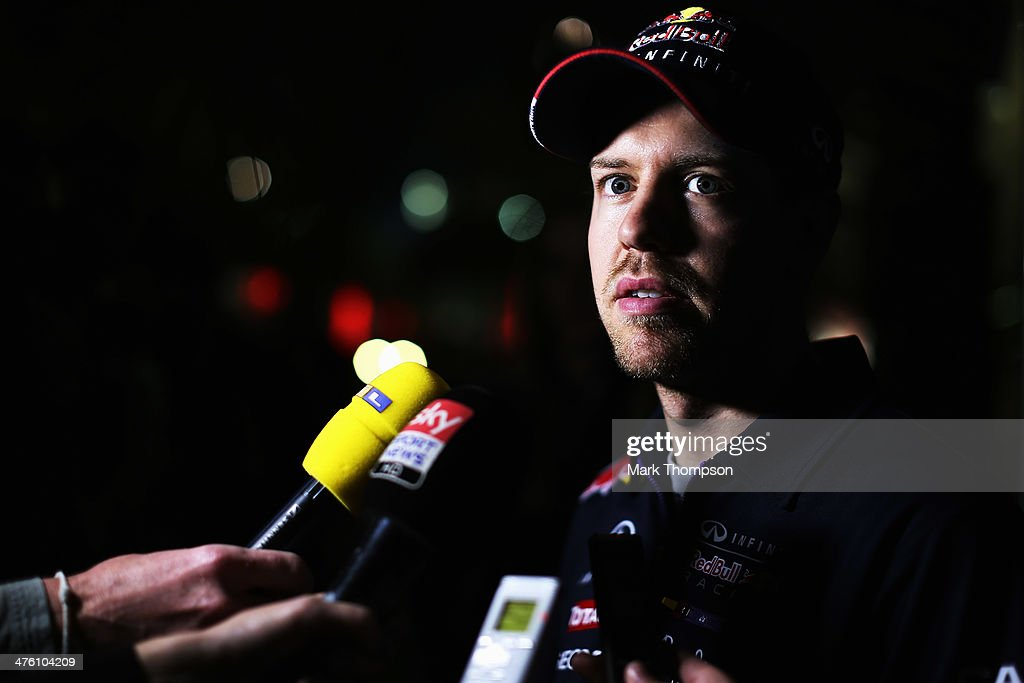 Sebastian Vettel of Germany and Infiniti Red Bull Racing is interviewed by the media during day four of Formula One Winter Testing at the Bahrain International Circuit on March 2, 2014 in Bahrain, Bahrain.