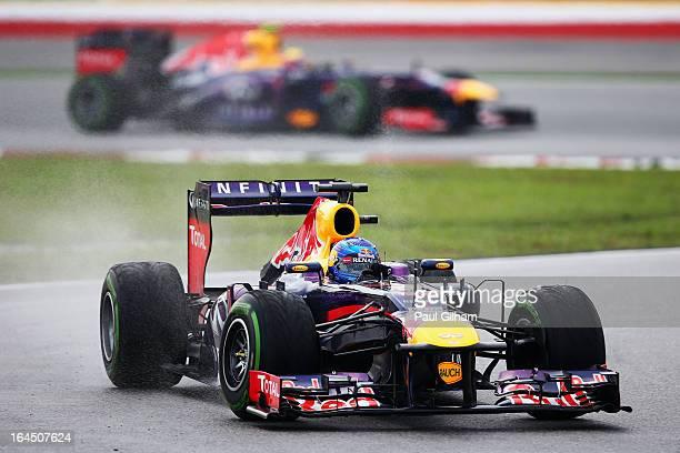 Sebastian Vettel of Germany and Infiniti Red Bull Racing leads from team mate Mark Webber of Australia and Infiniti Red Bull Racing during the...