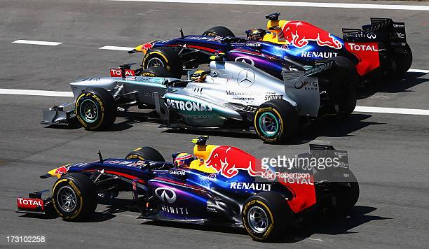Sebastian Vettel of Germany and Infiniti Red Bull Racing Lewis Hamilton of Great Britain and Mercedes GP and Mark Webber of Australia and Infiniti...