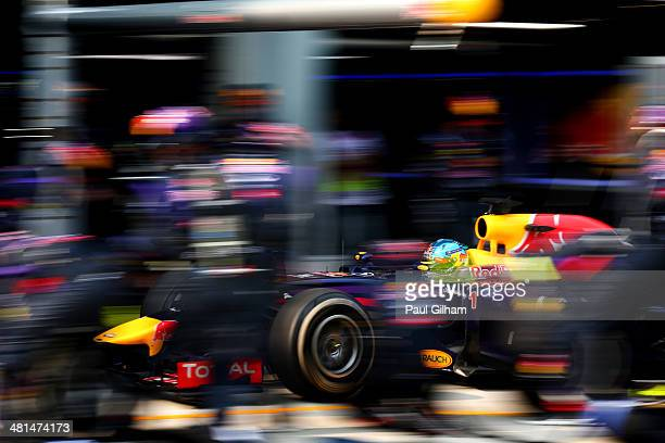Sebastian Vettel of Germany and Infiniti Red Bull Racing makes a pitstop during the Malaysia Formula One Grand Prix at the Sepang Circuit on March 30...