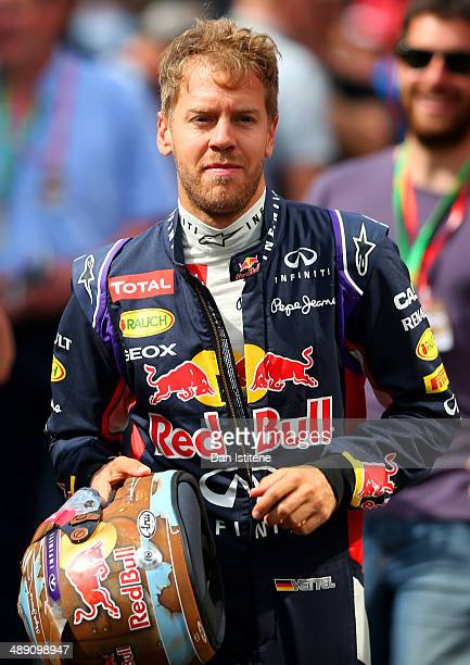 Sebastian Vettel of Germany and Infiniti Red Bull Racing runs to the garage for the final practice ahead of the Spanish F1 Grand Prix at Circuit de...