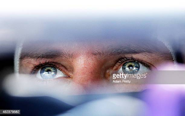Sebastian Vettel of Germany and Infiniti Red Bull Racing sits in his car in the garage during final practice ahead of the German Grand Prix at...