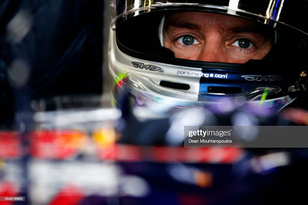 Sebastian Vettel of Germany and Infiniti Red Bull Racing sits in his car in the garage during the Belgian Grand Prix at Circuit de Spa-Francorchamps on August 24, 2014 in Spa, Belgium.