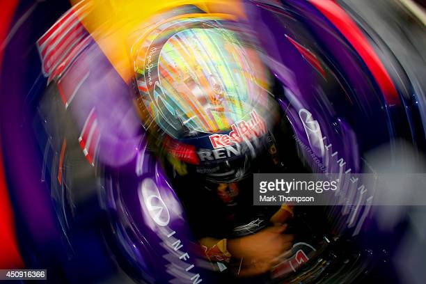 Sebastian Vettel of Germany and Infiniti Red Bull Racing waits in his car i nthe garage during practice ahead of the Austrian Formula One Grand Prix...