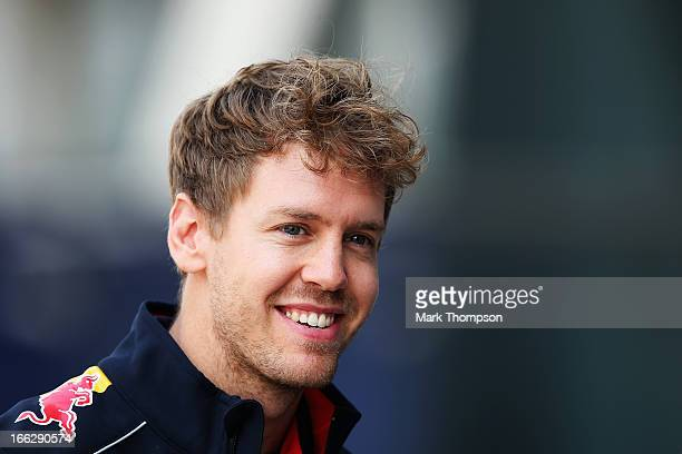 Sebastian Vettel of Germany and Infiniti Red Bull Racing walks in the paddock during previews to the Chinese Formula One Grand Prix at the Shanghai...