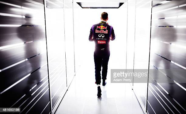 Sebastian Vettel of Germany and Infiniti Red Bull Racing walks out of the garage after final practice ahead of the German Grand Prix at...
