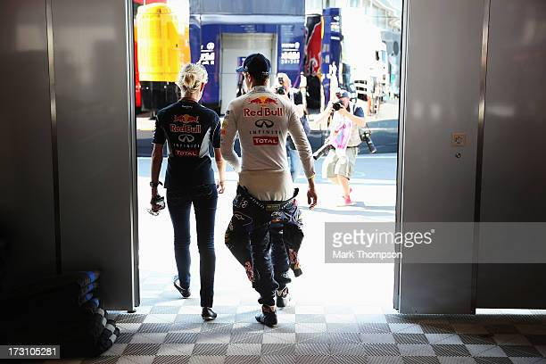 Sebastian Vettel of Germany and Infiniti Red Bull Racing walks with his press officer Britta Roeske after winning the German Grand Prix at the...