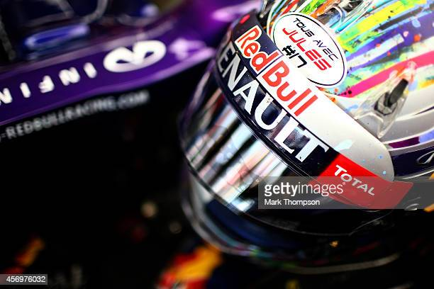 Sebastian Vettel of Germany and Infiniti Red Bull Racing's helmet displaying the message 'tous avec Jules' in support of Jules Bianchi of France and...