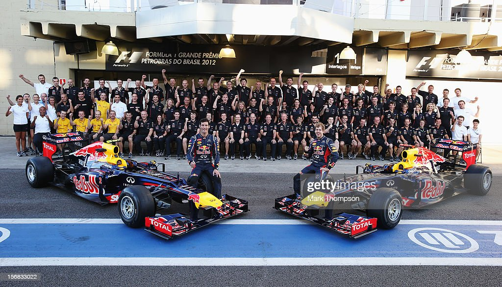 Sebastian Vettel (R) of Germany and Mark Webber (L) of Australia pose with Red Bull Racing team mates for an end of season photograph during previews for the Brazilian Formula One Grand Prix at the Autodromo Jose Carlos Pace on November 22, 2012 in Sao Paulo, Brazil.