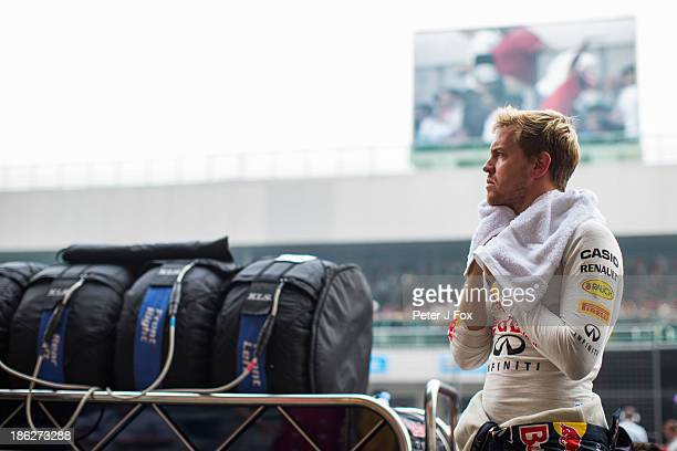 Sebastian Vettel of Germany and Red Bull looks on during the Indian Formula One Grand Prix at Buddh International Circuit on October 27 2013 in Noida...