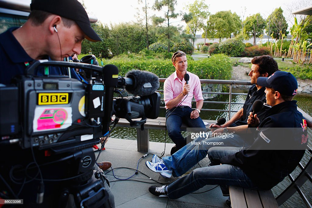 Sebastian Vettel (R) of Germany and Red Bull Racing and team mate Mark Webber (C) of Australia are interviewed by former F1 driver and now BBC F1 pundit David Coulthard (L) of Scotland following qualifying for the Chinese Formula One Grand Prix at the Shanghai International Circuit on April 18, 2009 in Shanghai, China.