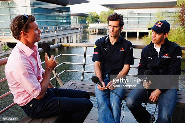 Sebastian Vettel of Germany and Red Bull Racing and team mate Mark Webber of Australia are interviewed by former F1 driver and now BBC F1 pundit...