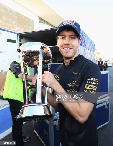 Sebastian Vettel of Germany and Red Bull Racing celebrates after his second place finish secures his team their third consecutive Constructors...