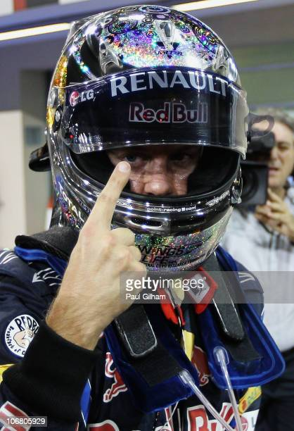 Sebastian Vettel of Germany and Red Bull Racing celebrates finishing first during qualifying for the Abu Dhabi Formula One Grand Prix at the Yas...