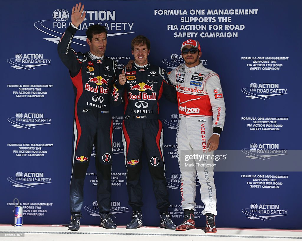 Sebastian Vettel (C) of Germany and Red Bull Racing celebrates finishing first alongside second placed Lewis Hamilton (R) of Great Britain and McLaren and third placed Mark Webber (L) of Australia and Red Bull Racing following qualifying for the United States Formula One Grand Prix at the Circuit of the Americas on November 17, 2012 in Austin, Texas.
