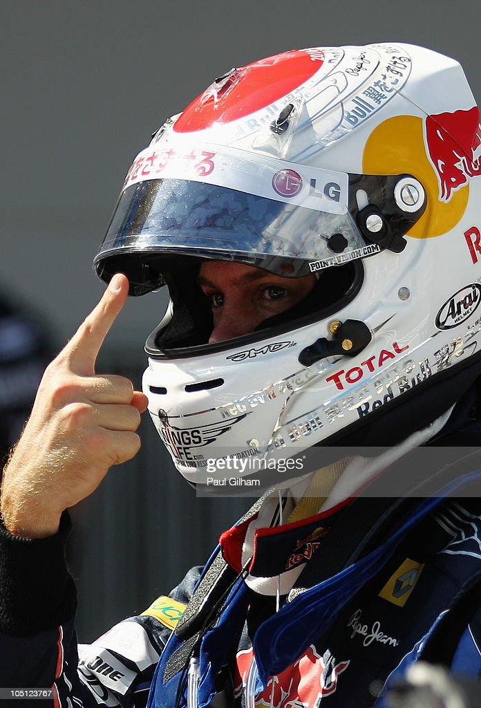 Sebastian Vettel of Germany and Red Bull Racing celebrates in parc ferme after finishing first during qualifying for the Japanese Formula One Grand Prix at Suzuka Circuit on October 10, 2010 in Suzuka, Japan.