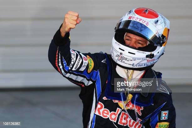 Sebastian Vettel of Germany and Red Bull Racing celebrates in parc ferme after winning the Japanese Formula One Grand Prix at Suzuka Circuit on...