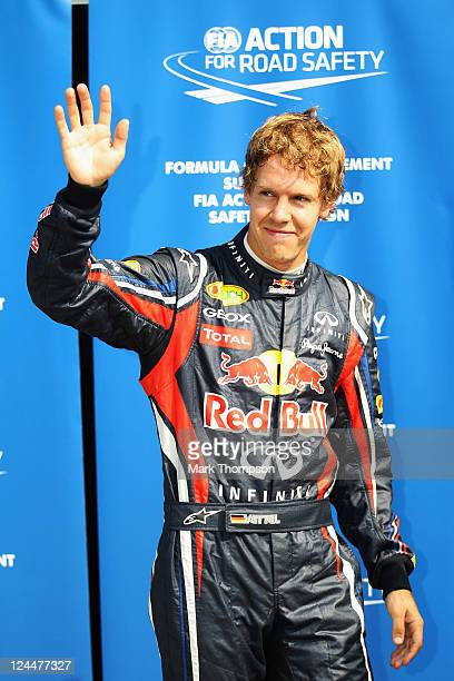 Sebastian Vettel of Germany and Red Bull Racing celebrates in parc ferme after finishing first during qualifying for the Italian Formula One Grand...