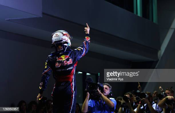 Sebastian Vettel of Germany and Red Bull Racing celebrates in parc ferme after winning the Singapore Formula One Grand Prix at the Marina Bay Street...