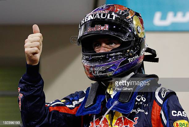 Sebastian Vettel of Germany and Red Bull Racing celebrates in parc ferme after finishing first during qualifying for the Abu Dhabi Formula One Grand...