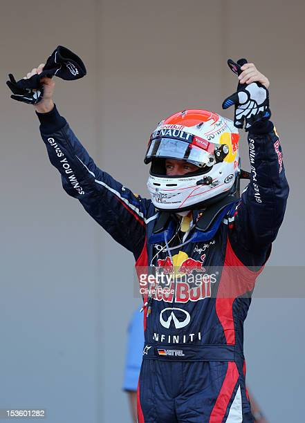 Sebastian Vettel of Germany and Red Bull Racing celebrates in parc ferme after winning the Japanese Formula One Grand Prix at the Suzuka Circuit on...
