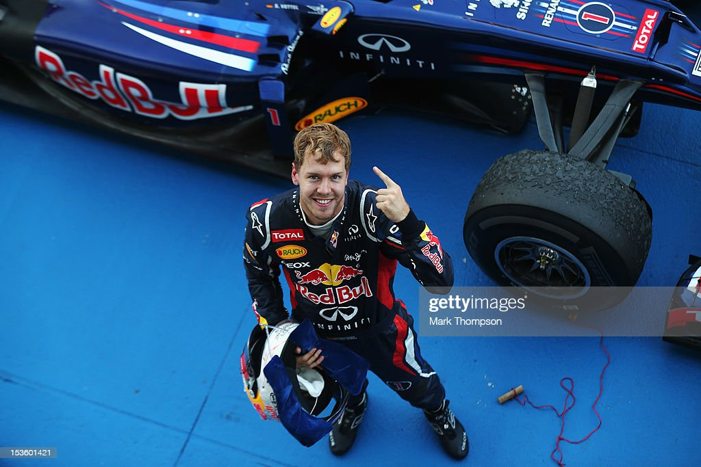 Sebastian Vettel of Germany and Red Bull Racing celebrates in parc ferme after winning the Japanese Formula One Grand Prix at the Suzuka Circuit on October 7, 2012 in Suzuka, Japan.