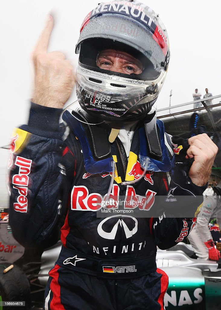 Sebastian Vettel of Germany and Red Bull Racing celebrates in parc ferme as he finishes in sixth position and clinches the drivers world championship during the Brazilian Formula One Grand Prix at the Autodromo Jose Carlos Pace on November 25, 2012 in Sao Paulo, Brazil.
