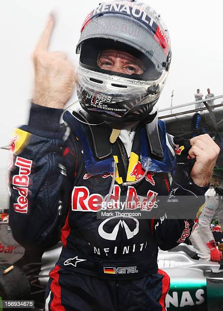 Sebastian Vettel of Germany and Red Bull Racing celebrates in parc ferme as he finishes in sixth position and clinches the drivers world championship...