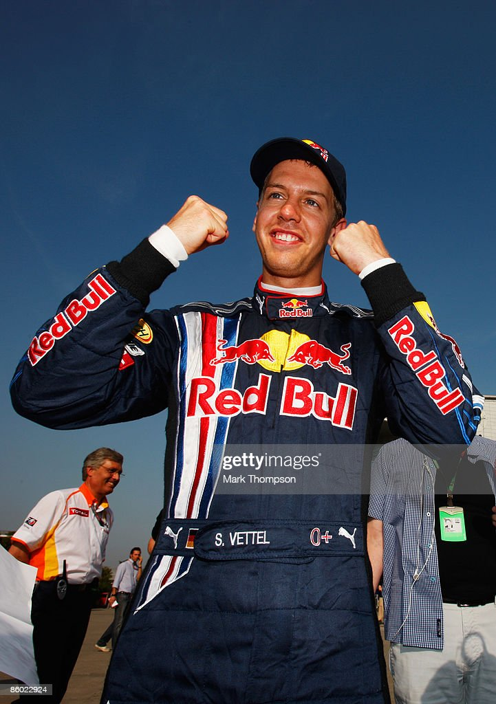 Sebastian Vettel of Germany and Red Bull Racing celebrates in the paddock after taking pole position during qualifying for the Chinese Formula One Grand Prix at the Shanghai International Circuit on April 18, 2009 in Shanghai, China.