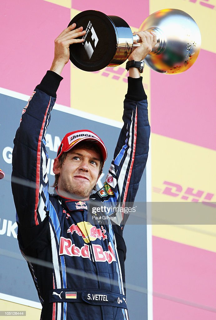 Sebastian Vettel of Germany and Red Bull Racing celebrates on the podium after winning the Japanese Formula One Grand Prix at Suzuka Circuit on October 10, 2010 in Suzuka, Japan.