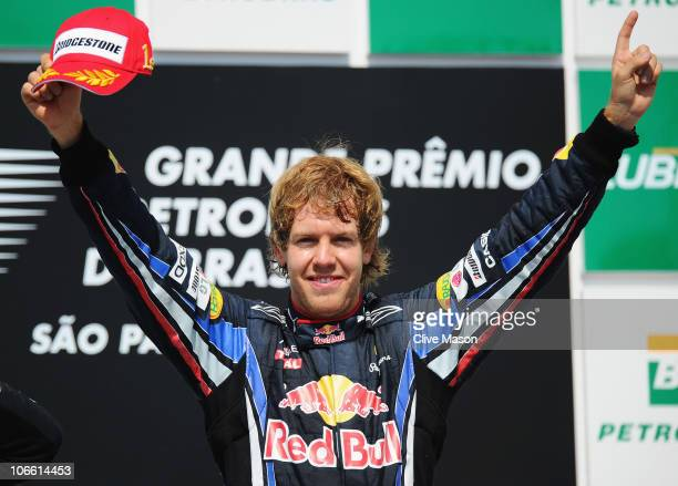Sebastian Vettel of Germany and Red Bull Racing celebrates on the podium after winning the Brazilian Formula One Grand Prix at the Interlagos Circuit...