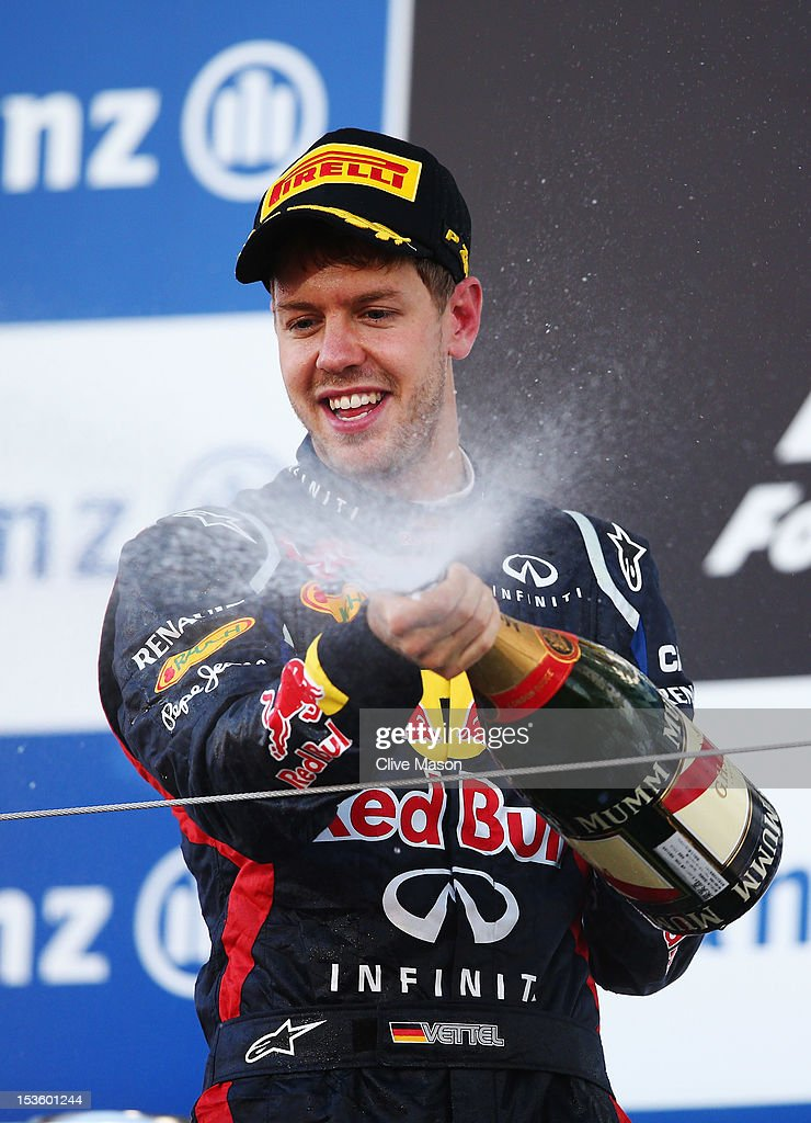 Sebastian Vettel of Germany and Red Bull Racing celebrates on the podium after winning the Japanese Formula One Grand Prix at the Suzuka Circuit on October 7, 2012 in Suzuka, Japan.