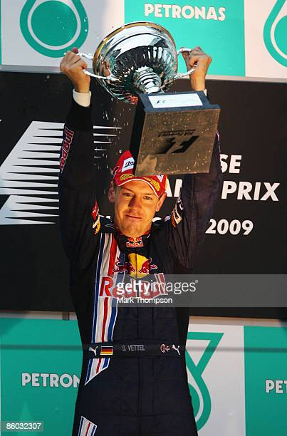 Sebastian Vettel of Germany and Red Bull Racing celebrates on the podium after winning the Chinese Formula One Grand Prix at the Shanghai...
