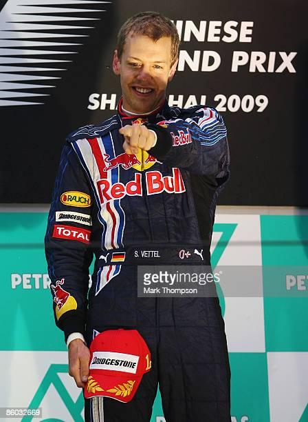 Sebastian Vettel of Germany and Red Bull Racing celebrates on the podium after the Chinese Formula One Grand Prix at the Shanghai International...