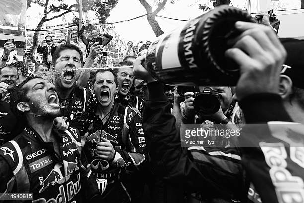 Sebastian Vettel of Germany and Red Bull Racing celebrates with team mates after winning the Monaco Formula One Grand Prix at the Monte Carlo Circuit...