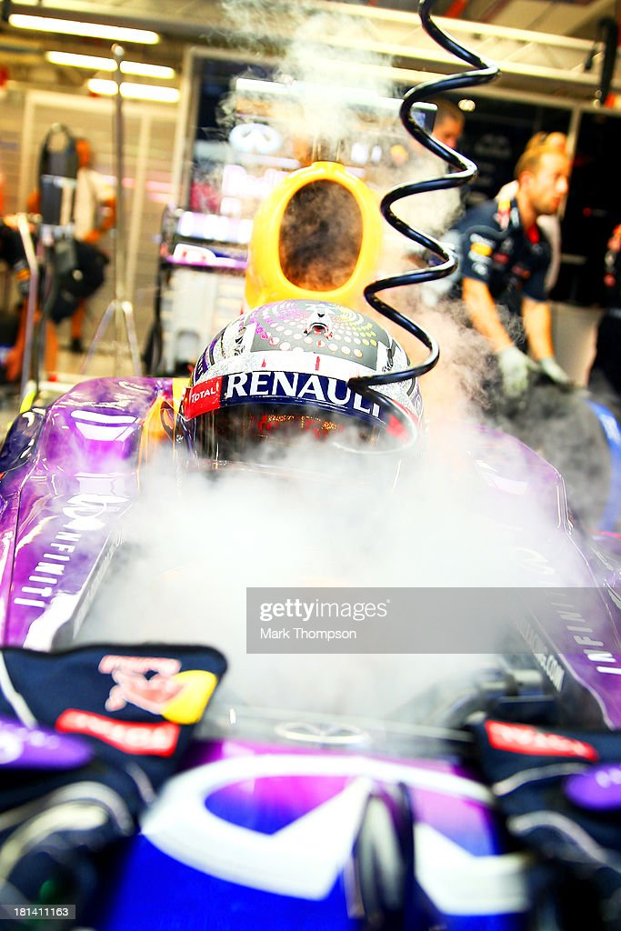Sebastian Vettel of Germany and Red Bull Racing cools his cockpit with dry ice during qualifying for the Singapore Formula One Grand Prix at Marina Bay Street Circuit on September 21, 2013 in Singapore, Singapore.