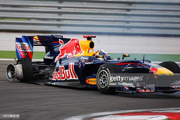 Sebastian Vettel of Germany and Red Bull Racing crashes out after colliding with his team mate Mark Webber of Australia and Red Bull Racing during...