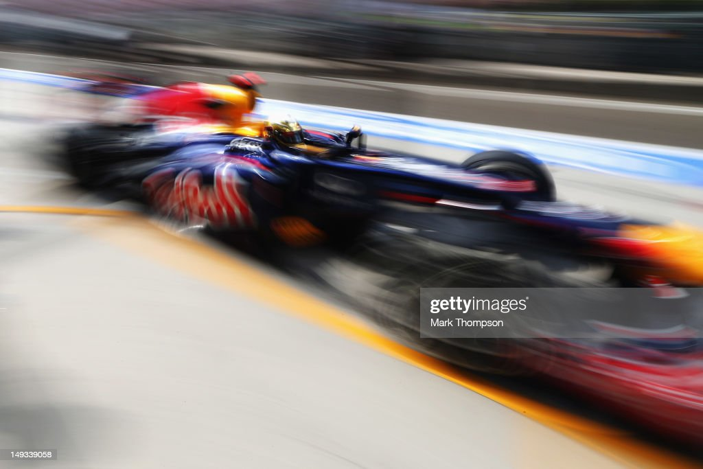 Sebastian Vettel of Germany and Red Bull Racing down the pitlane during practice for the Hungarian Formula One Grand Prix at the Hungaroring on July 27, 2012 in Budapest, Hungary.