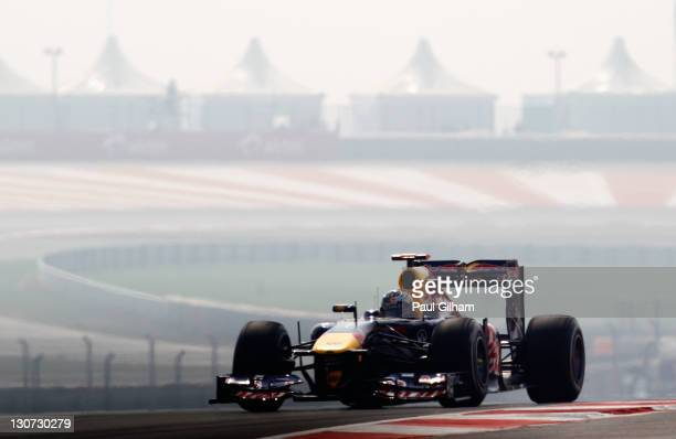 Sebastian Vettel of Germany and Red Bull Racing drives during the final practice session prior to qualifying for the Indian Formula One Grand Prix at...