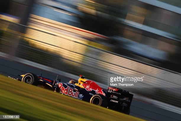Sebastian Vettel of Germany and Red Bull Racing drives on his way to finishing first during qualifying for the Abu Dhabi Formula One Grand Prix at...