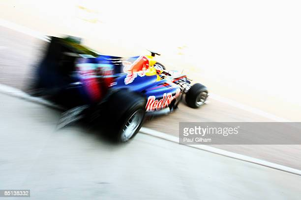 Sebastian Vettel of Germany and Red Bull Racing drives out of the team garage during Formula One winter testing at the Ricardo Tormo circuit on...