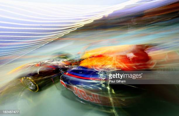 Sebastian Vettel of Germany and Red Bull Racing exits his garage to drive during practice for the Singapore Formula One Grand Prix at the Marina Bay...