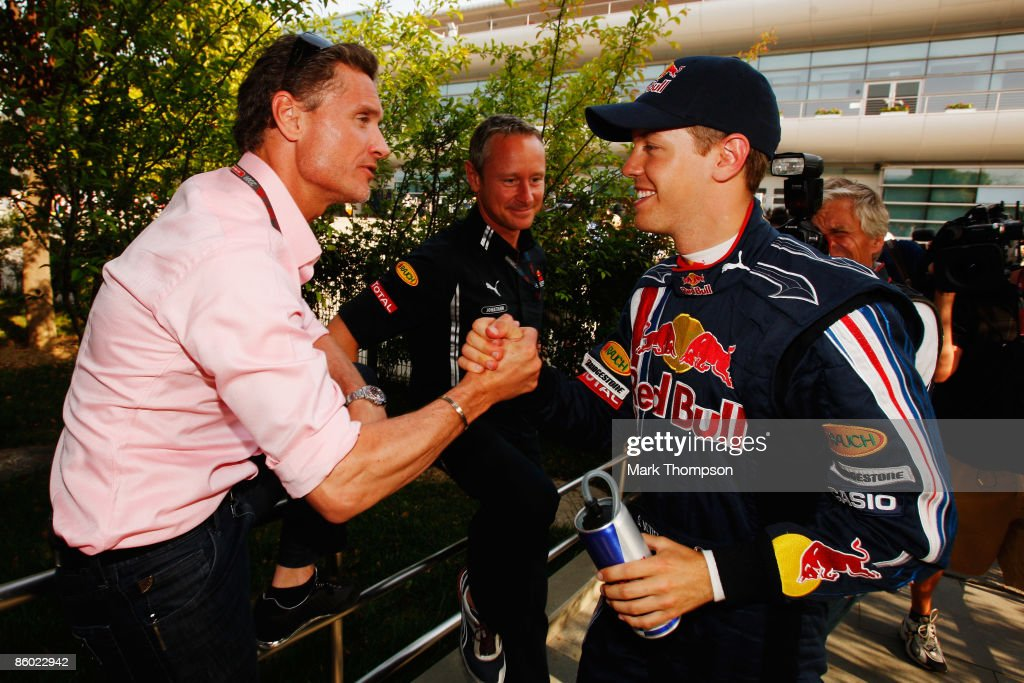 Sebastian Vettel (R) of Germany and Red Bull Racing is congratulated by former driver David Coulthard (L) of Scotland after taking pole position during qualifying for the Chinese Formula One Grand Prix at the Shanghai International Circuit on April 18, 2009 in Shanghai, China.