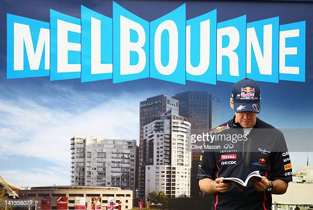Sebastian Vettel of Germany and Red Bull Racing is interviewed by the media during previews to the Australian Formula One Grand Prix at the Albert...