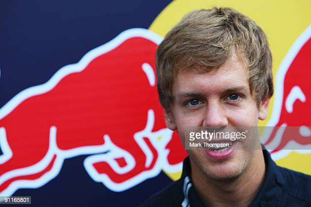 Sebastian Vettel of Germany and Red Bull Racing is interviewed in the paddock before qualifying for the Singapore Formula One Grand Prix at the...