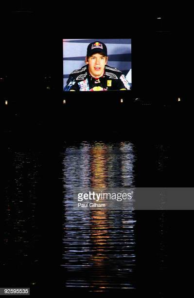 Sebastian Vettel of Germany and Red Bull Racing is seen on screen talking at the drivers press conference after winning the Abu Dhabi Formula One...