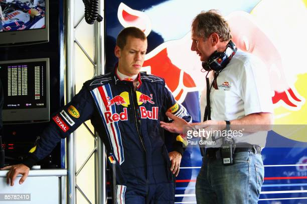 Sebastian Vettel of Germany and Red Bull Racing is seen talking with Dr Helmut Marko in his team garage during practice for the Malaysian Formula One...