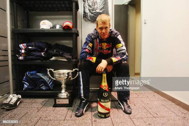 Sebastian Vettel of Germany and Red Bull Racing is seen with his winners trophy after the Chinese Formula One Grand Prix at the Shanghai...